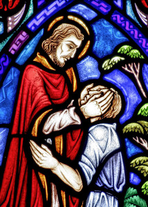 A church window depicts Jesus healing the blind man. (CNS photo/Crosiers) With Faith Alive! No. 13 MIDST, March 25, 2013.
